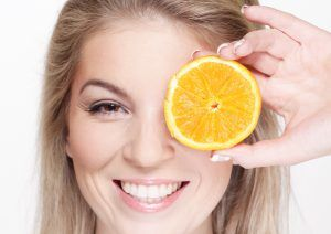 model with orange clean beauty