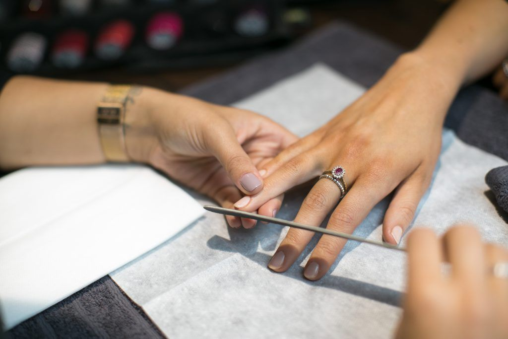 Filing nails women's manicure