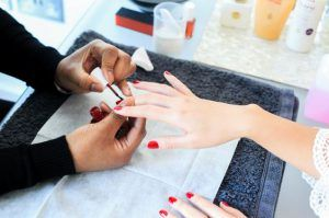 red manicure nail care