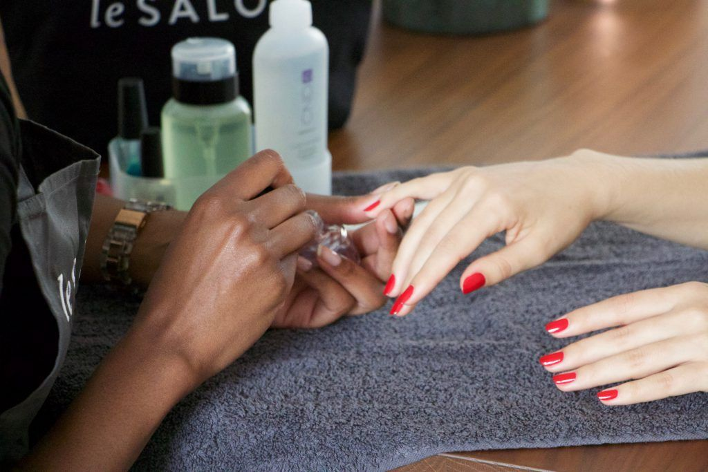 at home manicure with red nails